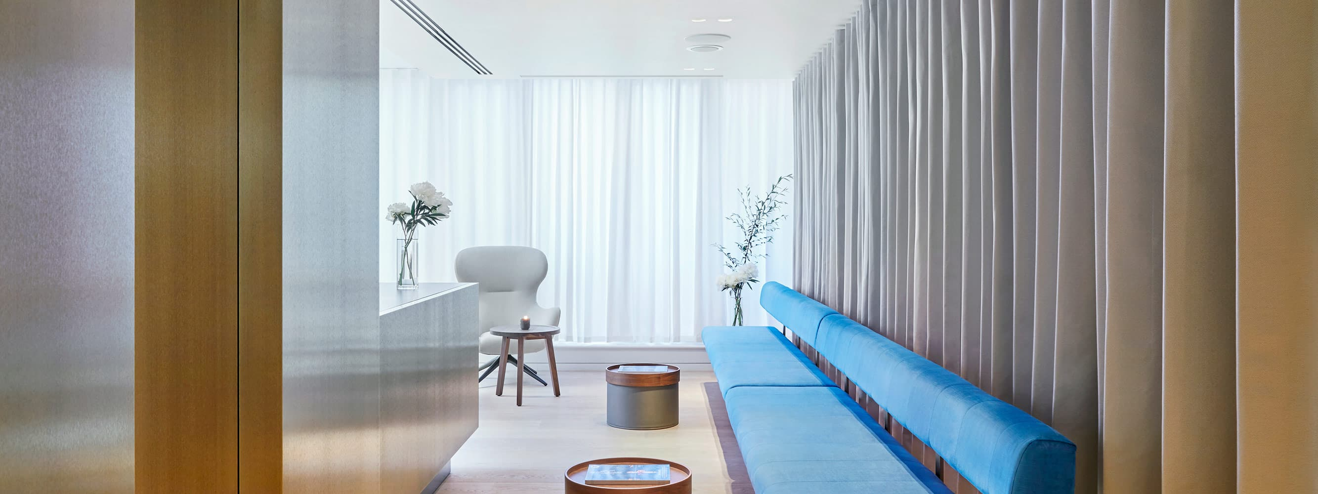 picture of the Medical Facility Entrance with blue sofa